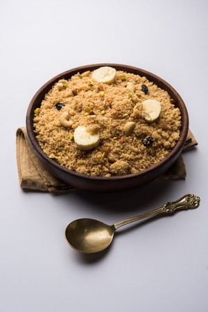 Semolina Halwa / Sooji ka Halva or sweet Rava Sheera or shira - Indian festival sweet made of semolina, nuts and Ghee