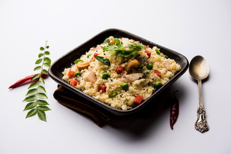 Rava Upma / Uppuma - south indian breakfast served in a bowl. selective focus Imagens