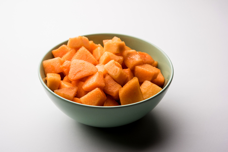 Cantaloupe / muskmelon / kharbuja cut into pieces, served in a bowl. selective focus