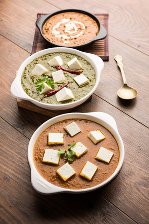 Palak paneer butter masala, yellow dal or dal-makhani served in a bowl in a group. selective focus