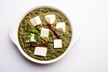 Palak Paneer Curry made up of spinach and cottage cheese served in a bowl. selective focus