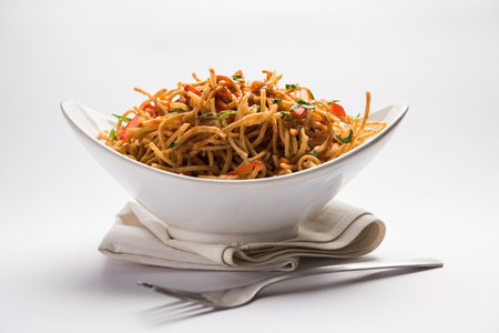 Chinese Bhel is a spicy indo-chinese recipe, served in a bowl. selective focus