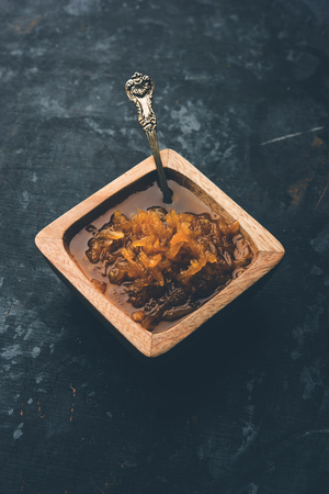 Mango Chunda or Sakhar Amba is a traditional indian summer recipe made using accha aam preserved in sugar syrup for days. selective focus 版權商用圖片