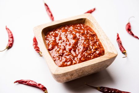 Schezwan Sauce / Szechuan chutney is an important ingredient in Chinese recipe. served in a bowl, isolated.  selective focus Banco de Imagens