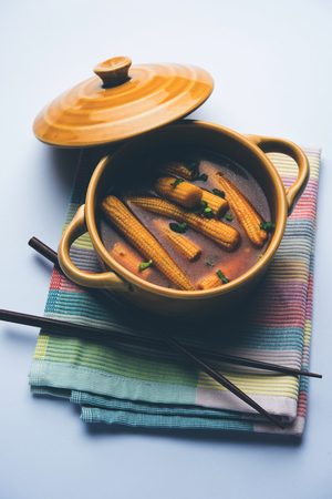 Baby Corn Manchurian with gravy - popular Indo-chinese recipe. selective focus Фото со стока