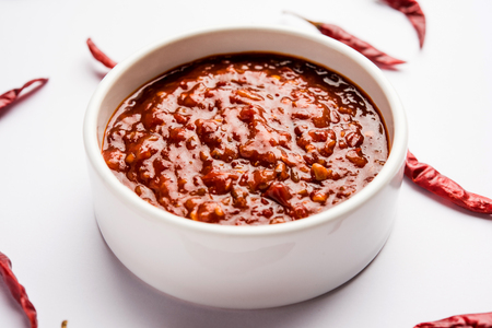 Schezwan Sauce  Szechuan chutney is an important ingredient in Chinese recipe. served in a bowl, isolated.  selective focus Stock Photo