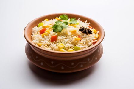 Corn Pilaf or Pulav made using boiled Maize seeds with rice and vegetables. selective focus