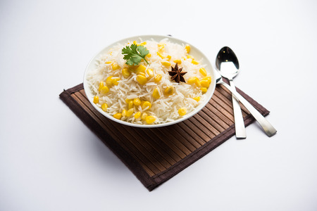 Corn Rice made using boiled Maize seeds with basmati rice, served in a bowl. selective focus Reklamní fotografie
