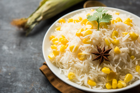 Corn Rice made using boiled Maize seeds with basmati rice, served in a bowl. selective focus Stock Photo