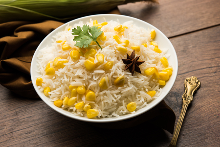 Corn Rice made using boiled Maize seeds with basmati rice, served in a bowl. selective focus 版權商用圖片
