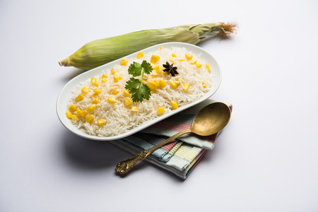 Corn Rice made using boiled Maize seeds with basmati rice, served in a bowl. selective focus Banco de Imagens