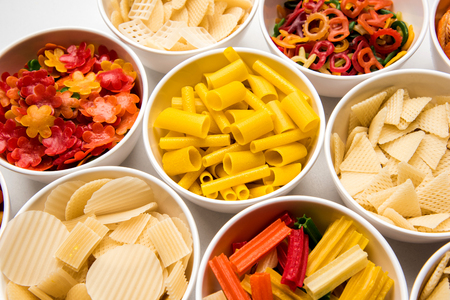 Snack pellets are non-expanded products made with raw materials like cereals, potatoes or vegetable powders, later processed using frying, hot air baking. multicoloured  shaped ready-to-eat snacks