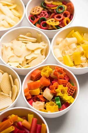 Snack pellets are non-expanded products made with raw materials like cereals, potatoes or vegetable powders, later processed using frying, hot air baking. multicoloured / shaped ready-to-eat snacks