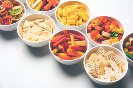 Snack pellets are non-expanded products made with raw materials like cereals, potatoes or vegetable powders, later processed using frying, hot air baking. multicolored  shaped ready-to-eat snacks