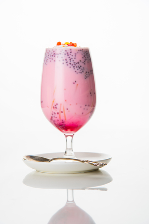 Falooda  Faluda is a popular Indian dessert - Strawberry and Mango flavoured which has Ice cream, noodles, sweet basil seeds and nuts, selective focus