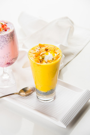 Falooda / Faluda is a popular Indian dessert - Strawberry and Mango flavoured which has Ice cream, noodles, sweet basil seeds and nuts, selective focus