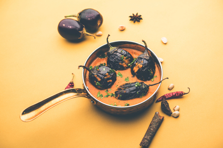 Baingan masala / Eggplant / brinjal curry served in bowl or pan, selective focus Stock Photo