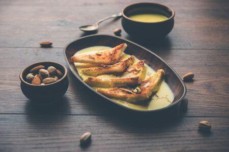 Hyderabadi Bhindi ka Salan or Okra salan made using ladies fingers or ochro. Main course recipe from India. served in a bowl. selective focus