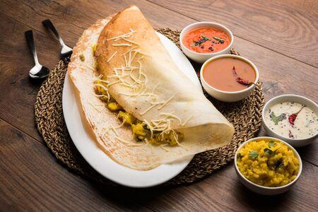 cheese masala dosa recipe with sambar and chutney, selective focus Stock Photo