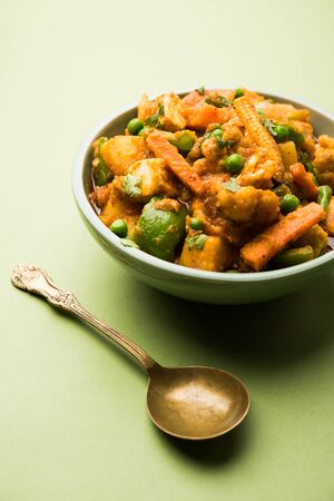 Mix vegetable curry - Indian main course recipe contains Carrots, cauliflower, green peas and beans, baby corn, capsicum and paneer/cottage cheese with traditional masala and curry, selective focus Stock Photo