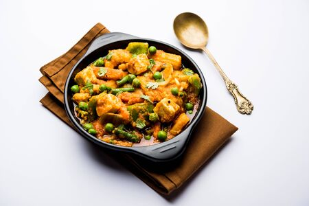 Mix vegetable curry - Indian main course recipe contains Carrots, cauliflower, green peas and beans, baby corn, capsicum and paneer/cottage cheese with traditional masala and curry, selective focus Stock fotó