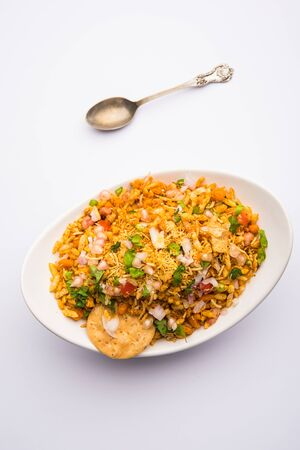 Bhelpuri Chaat/chat is a road side tasty food from India, served in a bowl or plate. selective focus