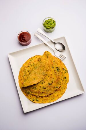 Chilla or Besan cheela is a simple pancake made with chickpea flour and some basic ingredients served with green chutney and tomato sauce, also known as veg-omelette