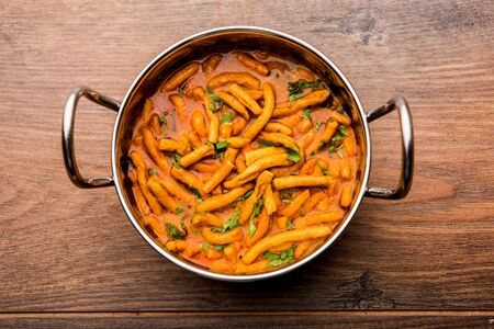 Dhaba style Sev bhaji/sabzi/curry made in tomato curry with gathiya shev, served in a bowl or karahi, selective focus Stock Photo