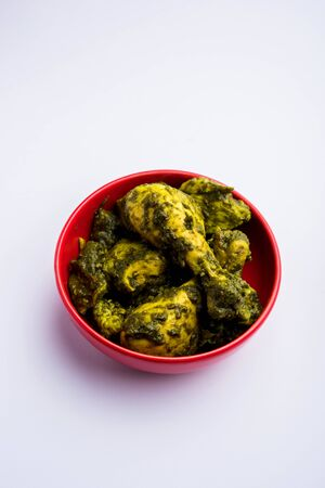 Undhiyu is a Gujarati mixed vegetable dish, specialty of Surat, India. Served in a bowl with or without poori Stock Photo - 130717925