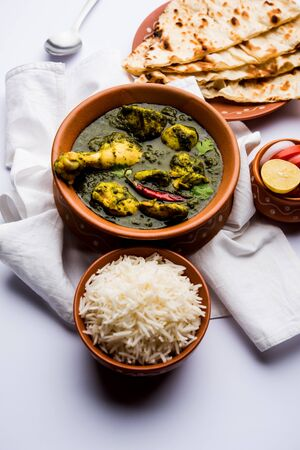 Undhiyu is a Gujarati mixed vegetable dish, specialty of Surat, India. Served in a bowl with or without poori Stock Photo - 130718028