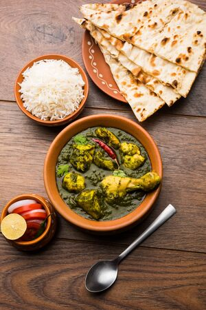 Undhiyu is a Gujarati mixed vegetable dish, specialty of Surat, India. Served in a bowl with or without poori Stock Photo - 130718355