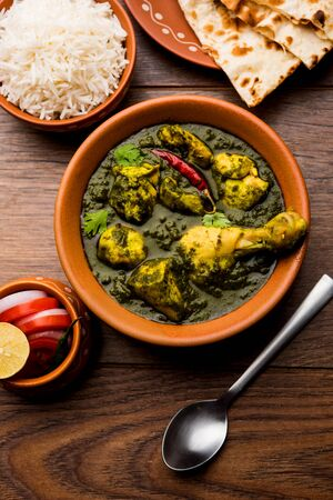Undhiyu is a Gujarati mixed vegetable dish, specialty of Surat, India. Served in a bowl with or without poori Stock Photo - 130718359