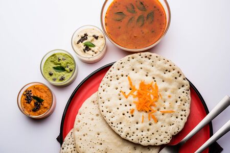 Set Dosa  Oothappam style dosa is a popular south Indian food served with sambar and chutney, selective focus