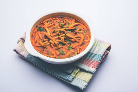 Dhaba style Sev bhajisabzicurry made in tomato curry with gathiya shev, selective focus Stock Photo