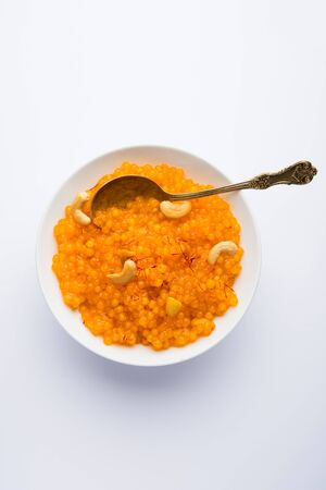 Sabudana or Sago Kesari dessert for Vrat Upvas also known as Sweetened Tapioca Pearl. served in a bowl. selective focus