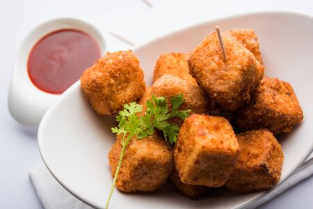 Crispy Paneer popcorn is a popular party snack and an appetiser. selective focus