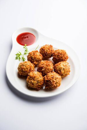 Crispy Noodles/maggie Pakora or pakoda is a popular indochinese street food served with ketchup 写真素材
