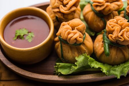Crispy Potli Samosa or veg money bags are delicious Indian snacks of spiced aloo and mix veggies Or Meat/kheema  stuffed in flaky dough. It's a great creative starter or appetiser. served with ketchup