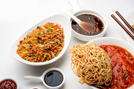Assorted Indo chinese dishes in group includes Schezwan/Szechuan hakka noodles, veg fried rice, veg manchurian, american chop suey, chilli paneer, crispy vegetable and vegetable soup