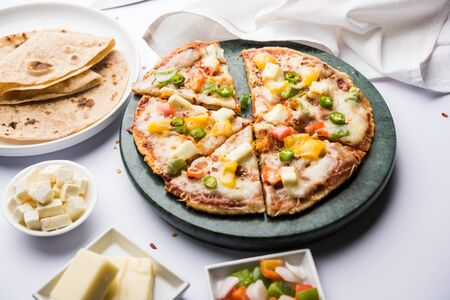 Chapati Pizza made using leftover Roti / Paratha with Cheese, vegetables, paneer and Sausage