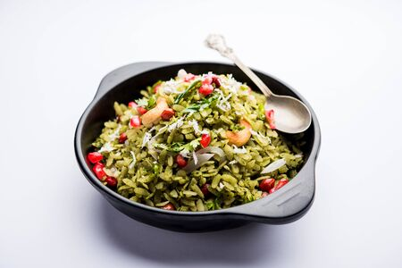 Hariyali Poha / Green Masala Pohe or flattened rice served in a bowl, selective focus 写真素材