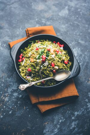 Hariyali Poha / Green Masala Pohe or flattened rice served in a bowl, selective focus Stok Fotoğraf