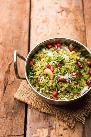 Hariyali Poha / Green Masala Pohe or flattened rice served in a bowl, selective focus Stock Photo
