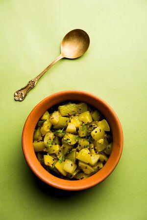 Lauki/doodhi ki soothe Sabji also known as bottle gourd dry sabzi. served in a bowl or karahi. selective focus