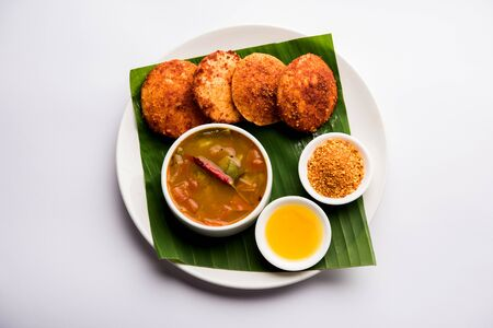 Podi idli is a quick and easy snack made with leftover idly. served with sambar and coconut chutney. selective focus Stock Photo