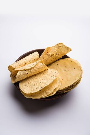 Gujarati papad or papadum in raw dried form with roasted cone, roll and flat variation Stock Photo