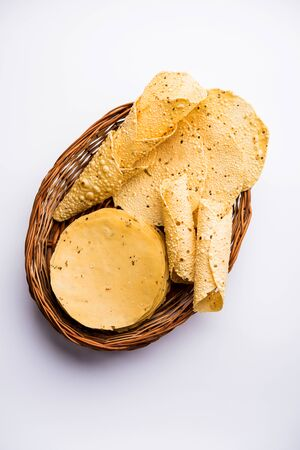 Gujarati papad or papadum in raw dried form with roasted cone, roll and flat variation 写真素材