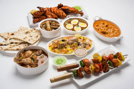 Assorted Indian Non Vegetarian food recipe served in a group. Includes Chicken Curry, Mutton Masala, Anda/egg curry, Butter chicken, biryani, tandoori murgh, chicken-tikka and naan/roti