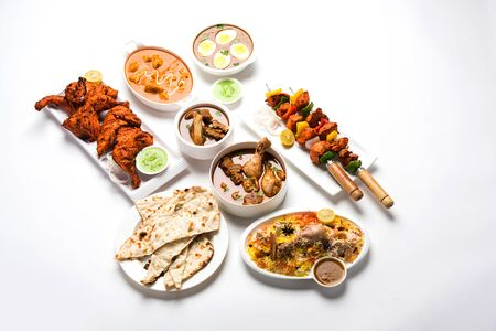 Assorted Indian Non Vegetarian food recipe served in a group. Includes Chicken Curry, Mutton Masala, Anda/egg curry, Butter chicken, biryani, tandoori murgh, chicken-tikka and naan/roti Reklamní fotografie
