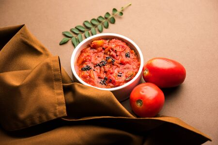 Tomato/tamatar chutney or sauce, served in a bowl. selective focus Stock Photo
